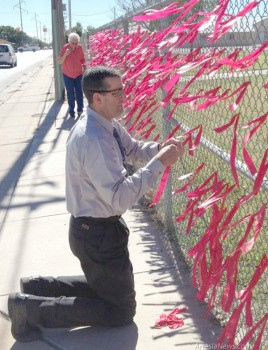 "Artesia Public Schools Assistant Superintendent John Ross Null and Artesia Drug & Crime Coalition Manager Nancy Husselman tie red ribbons on a fence at Bulldog Pit last week in honor of Red Ribbon Week. Ribbons were tied to fences at Artesia High School, Artesia (Park) Junior High and Artesia (Zia) Intermediate as part of the schools' pledge to be drug free. The ADCC would like to thank Navajo Refining and Eddy County DWI for providing the Red Ribbon Week materials passed out to all schools. The ADCC would also like to give special thanks to the ""Friends of Rachel,"" ""Make a Difference"" and ""Teen'z Talk"" student action groups for their hard work and dedication to serving Artesia's youth in a positive way and their sponsors, Anna Kalley, Yvonne Branch and Connie Medley-Young. Courtesy Photo"