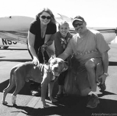 From left, Cindy Perini, president of Paws & Claws, poses with Abigail and Kriss Childress and Amato. Kriss Childress is a volunteer with Pilots N Paws and flew down from Colorado to give Amato a ride to his rescue in Evergreen, Colo.