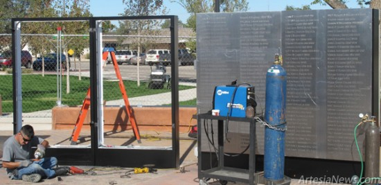 Workers install the Wall of Honor, a collection of metal placards listing the names of roughly 600 local veterans, this morning in the newly-renovated Baish Park. The official dedication ceremony for the park, located in front of City Hall, is scheduled for Nov. 12. Rob Larson  Daily Press