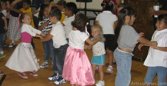 Students at Grand Heights Early Childhood Center dance the afternoon away at the schools Seventh Annual Sock Hop Tuesday. The kindergarteners dressed in their '50s finest and were treated to root beer floats and other themed snacks.