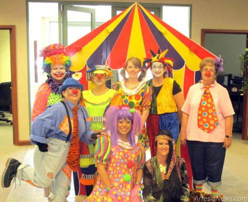 Employees of Western Bank clown around this morning in their big top-inspired Halloween costumes. Throughout Artesia today, businesses and students were getting in the spirit for tonights All Hallows Eve festivities. More photos of Artesias Halloween celebrations will be featured in the coming days. Rob Larson - Daily Press
