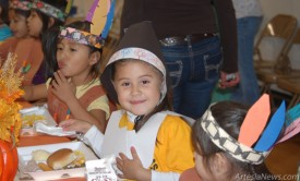 Students at Grand Heights Early Childhood Center don pilgrim and Native American finery Tuesday for the school's annual Thanksgiving feast. Courtesy Photos