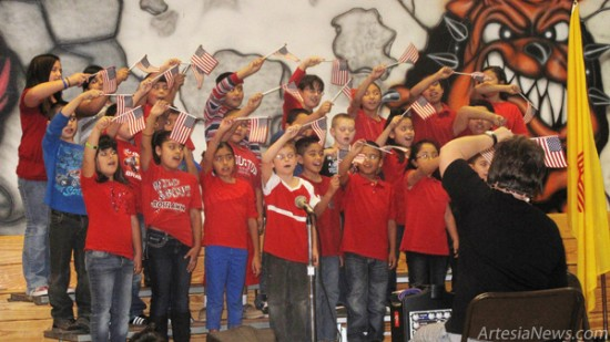 Third-grade students at Roselawn Elementary School, under the direction of Debra Leonard, perform a preview show Wednesday afternoon of the upcoming Veterans' Day program. Third-graders from all five elementary schools will perform a free Veterans' Day program at 10 a.m. Friday, Nov. 9, at the Artesia High School Auditorium.  Staci Guy – Daily Press