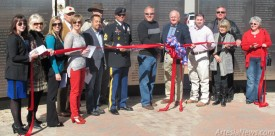 From left, Rebecca Prendergast, manager of Artesia MainStreet; Janice Southard Burk; Debbie Brown and Hayley Klein of the Artesia Chamber of Commerce; Peyton Yates, president of Artesia MainStreet; Jose Zelaya, Baish Veterans' Park's architect; Norbert McCaw; Sgt. Major William Fisk, the ceremony's keynote speaker; Ronnie Jackson; Mayor Phillip Burch; Jesse Brownfield; Theresa Baize; David Grousnick; and Susie McCaw cut the ribbon officially opening the Baish Veterans' Park dedication ceremony Monday. Rob Larson – Daily Press
