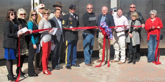 From left, Rebecca Prendergast, manager of Artesia MainStreet; Janice Southard Burk; Debbie Brown and Hayley Klein of the Artesia Chamber of Commerce; Peyton Yates, president of Artesia MainStreet; Jose Zelaya, Baish Veterans' Park's architect; Norbert McCaw; Sgt. Major William Fisk, the ceremony's keynote speaker; Ronnie Jackson; Mayor Phillip Burch; Jesse Brownfield; Theresa Baize; David Grousnick; and Susie McCaw cut the ribbon officially opening the Baish Veterans' Park dedication ceremony Monday.
