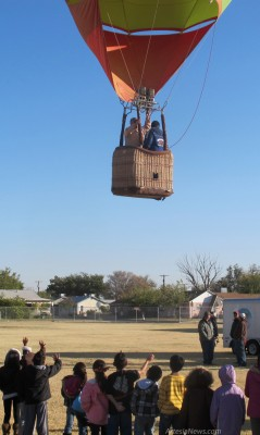 Roselawn Elementary School students wave goodbye as Bill Glen, a retired schoolteacher from Roswell, takes flight in his hot air balloon, Skittles, this morning. Hot air balloon pilots took off from many of the Artesia Public Schools to officially kick off the 2012 Balloons and Bluegrass Festival in Artesia.  Rob Larson – Daily Press