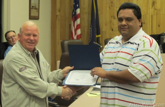 Mayor Pro Tem Terry Hill, left, presents Rafael Zamarron with a certificate on behalf of the Artesia City Council and Mayor Phillip Burch during Tuesday's council meeting. Zamarron has been serving the people of Artesia as a detention officer with the Artesia Police Department for five years. Rob Larson – Daily Press