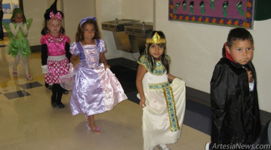 Students at Grand Heights Early Childhood Center parade their Halloween costumes through the halls of the school Wednesday. 