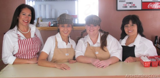 Hobo's Meat and Bread Owner Sonya McKnight stands with her two workers, Adrianna and Jessica, and Hobo's chef and manager, Chef Rosie.  Rob Larson – Daily Press