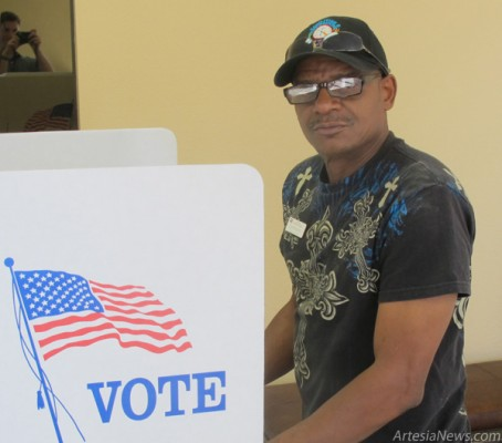 Lawrence Bishop of Artesia fills out his ballot Tuesday morning at Faith Baptist Church. As of 11:30 a.m., Faith Baptist had submitted 155 ballots to be counted.  Rob Larson - Daily Press