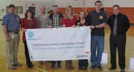 Representatives with Devon Energy join Artesia (Zia) Intermediate School science teachers Jessica Sanders and Jawna Carlo and Principal Jim Moore this morning to present the school with a $15,000 Devon Science Giants Award for demonstrating excellence in science education. For Sanders, Carlo and the rest of Zia, the grant came as a completely unexpected surprise. According to a press release, Devon launched the award to recognize schools for helping students excel in science and preparing them for college and future careers. Along with the $15,000 grant for Zia, Devon will also be giving a $5,000 grant to PR Leyva Middle School in Carlsbad this afternoon. Moore said the grant will go toward purchasing 10 new iPads for each classroom, giving students a more interactive learning experience than before. Rob Larson  Daily Press