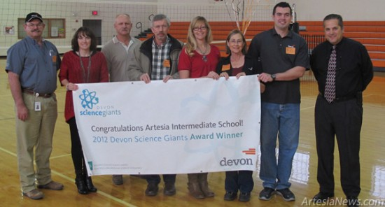 Representatives with Devon Energy join Artesia (Zia) Intermediate School science teachers Jessica Sanders and Jawna Carlo and Principal Jim Moore this morning to present the school with a $15,000 Devon Science Giants Award for demonstrating excellence in science education. For Sanders, Carlo and the rest of Zia, the grant came as a completely unexpected surprise. According to a press release, Devon launched the award to recognize schools for helping students excel in science and preparing them for college and future careers. Along with the $15,000 grant for Zia, Devon will also be giving a $5,000 grant to PR Leyva Middle School in Carlsbad this afternoon. Moore said the grant will go toward purchasing 10 new iPads for each classroom, giving students a more interactive learning experience than before. Rob Larson – Daily Press