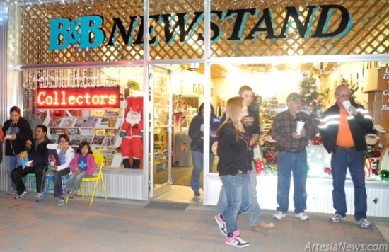 Artesians stop by B&B Newsstand for drinks before continuing along Main Street during Thursday's annual Light Up Artesia event, sponsored by Artesia MainStreet and the Artesia Chamber of Commerce.