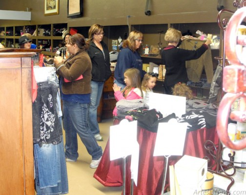 Shoppers peruse the selection at The Blue Lily. Brienne Green - Daily Press