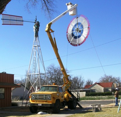 Workers with Cherokee Builders and the City of Artesia work Thursday to raise the fan on the windmill located at the Artesia Historical Museum and Art Center. Courtesy Photos