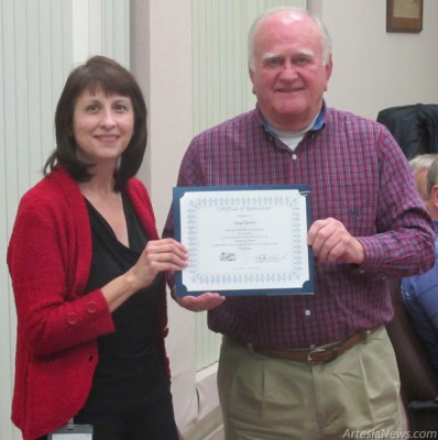 Mayor Phillip Burch presents an award on behalf of the Artesia City Council to Community Development Director Tina Torres. Torres was recognized for serving the people of Artesia for five years. Rob Larson – Daily Press