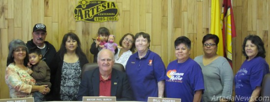 From left, Sofia Saiz, Jett Chavez, Pastor William Saavedra, Sally Carrera, Mayor Phillip Burch, Adalyn Cano, Adela Cabezuela, Women of the Moose Officers Doris Reiser and Wanda Long, and Maria and Alicia Bustamante came together Thursday afternoon to declare December 2012 as Donate a Toy Month in Artesia. As the proclamation states, the spirit of holiday giving continues through generous donations to local toy drives. Toy drives supply not only toys to children in need but also spread the gift of a smile to children and their families. Through the Forever Free Fellowship's Good Shepherd Toy Drive – which will hold a collection blitz from 11 a.m. – 5 p.m. Saturday, Dec. 8, at the corner of 13th and Main streets – the holiday spirit will be felt throughout the community as well as in the hearts of the children receiving gifts. For more information on the toy drive, contact Saiz at 703-7930.