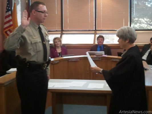 Eddy County Sheriff Scott M. London is officially sworn in this morning by Fifth Judicial District Judge Jane Shuler-Gray at a meeting of the Eddy County Commission in     Carlsbad. Rob L arson - Daily Press