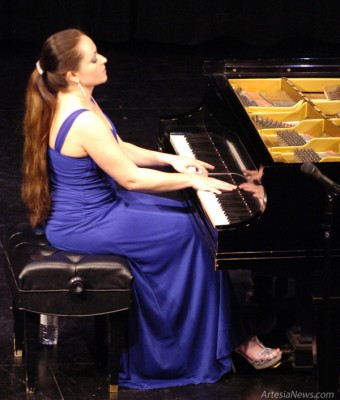 "Yana Reznik performs ""Fantasie Impromptu"" by Frederic Chopin during a concert Tuesday at the Ocotillo Performing Arts Center. Reznik, a Russian-born classical pianist who has performed with the Moscow Chamber Orchestra and Los Angeles Philharmonic and is a winner of the Artists International Competition, delighted the audience with a program that also included works by Rachmaninoff, Tchaikovsky and Liszt. Brienne Green - Daily Press"