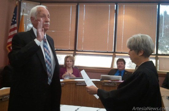 Shuler-Gray administers the oath of office to Glenn Collier. Rob Larson - Daily Press