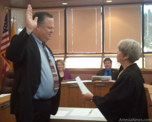 Royce Pearson is sworn into the Eddy County Commission Wednesday morning by Fifth Judicial District Judge Jane Shuler-Gray. Rob Larson - Daily Press