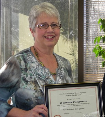 Gemma Ferguson, left, chief deputy assessor in the Eddy County Assessor's Office, receives her State of New Mexico Certified Appraiser Certificate. Ferguson has completed the mandatory courses required by the state Property Tax Division. Courtesy Photo
