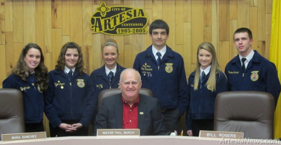"From left, FFA representatives Joy Menefee, Kayli Lynch, Tori Null, Trey Yates, Laney Hannigan and Weston Leonard look on Thursday morning as Mayor Phillip Burch declares FFA Week in Artesia. According to the proclamation, FFA and agricultural education provide a strong foundation for the youth of America and the future of the food, fiber and natural resource systems. As their motto – ""learning to do, doing to learn, earning to live, living to serve"" – suggests, FFA promotes leadership, personal growth and career success among its members. Agriculture education and FFA ensure a steady supply of young professionals to meet the growing demands in the science, business and technology of agriculture. Rob Larson – Daily Press"