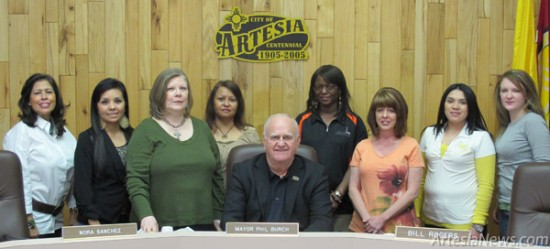 From left, Lupe Herrera, Vanessa Armendariz, Lavelta Jenkins, Nancy Franco, Tyndai Thorson, Ruth Anne Stubblefield, Janet Bahena and Courtney Patrom look on as Mayor Phillip Burch declares March 2013 as Desk & Derrick Awareness Month. As the proclamation reads, the purpose of Desk & Derrick Clubs is to promote the education and professional development of individuals employed in or affiliated with the petroleum, energy and allied industries. In 1982, the Desk & Derrick Educational Trust was established to give assistance to individuals pursuing college degrees related to these industries.  Rob Larson – Daily Press