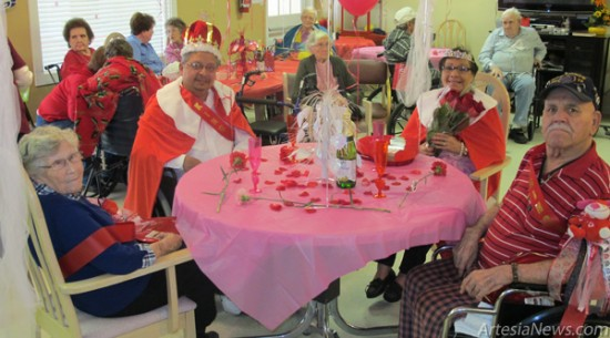 Clockwise from left, Princess Vivian Deans, King Michael Galvan, Queen Antonia Gallegos and Prince Jose Ponce sit at the head table after being crowned Thursday during Heartland Care Center's Valentine's Day party. Rob Larson – Daily Press