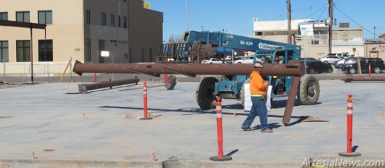 "Construction workers with Jaynes Corporation use a forklift Wednesday afternoon to move a massive steel beam at the site of Artesia's new public library. Todd Casper, superintendent for the project, said most of the steel work will be wrapped up by the end of next week, and once that's finished, ""things are really going to be moving quickly around here."" Rob Larson – Daily Press"