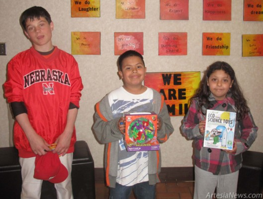 Among the many door prize winners were sixth-grader Ty Johnson, fourth-grader Jesus Lara, and third-grader Maribell Ruiz. Grace Miller - Daily Press