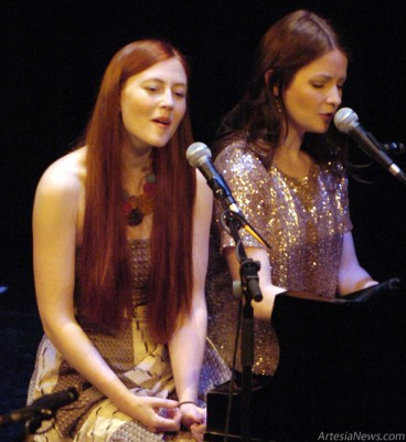 "Amanda Walther, left, and Sheila Carabine of the Canadian folk duo Dala entertain the crowd Tuesday at the Ocotillo Performing Arts Center. Winners of the 2010 Canadian Folk Music Award for Vocal Group of the Year, Walter and Carabine, best friends who met in their high school music class in 2002, have released five studio albums. Their most recent, ""Best Day,"" earned three Canadian Folk Music Award nominations. The pair's haunting harmonies atop catchy guitar and piano arrangements were punctuated with humorous interludes that kept the crowd engaged to the very last song, an audience-participation rendition of ""All I Have to Do is Dream,"" made famous by the Everly Brothers. Brienne Green - Daily Press"