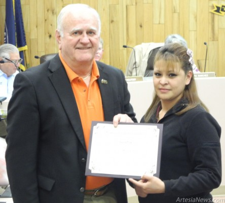 Mayor Phillip Burch awards a certificate to Janeth Cox, a wastewater operator with the Wastewater Department, at Tuesday's City Council meeting. Cox recently received her Level I Wastewater Certificate with the State of New Mexico. Rob Larson – Daily Press
