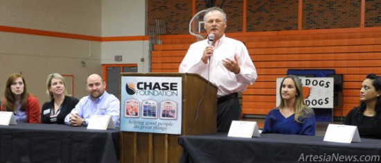 """For the seventh year, Chase Foundation Director Richard Price, above, was pleased Tuesday to present the 2013 Chase Scholarship recipients with information needed for this unique and wonderful opportunity. The eager """"college students to be"""" and their parents filled the old boys' gym at Artesia High School to receive the message from the organization, as it echoed, """"If you have received this scholarship, please do not take it for granted. The guidelines, responsibility, requirements and criteria have been made fair and easy to be met, so push yourself further and give yourself room to breathe with ease, and each student must do their part to maintain the integrity of this scholarship."""" Also on hand were representatives from the numerous New Mexico and West Texas colleges that have partnered with the Chase Foundation to further aid students. At left, Jaylen Fuentes and parents Tammy and Christopher Fuentes made a bee line to Jaylen's first choice college, Texas Tech University. Jaylen says he plans to major in Engineering and is """"looking forward to getting started, with a 4.0 GPA."""" His parents are confident their son's choice is right for him, as his interest in math and science have been strong since he was a child. Both said they are very grateful for the Chase Scholarship opportunity. Grace Miller - Daily Press"""