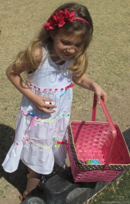 Emmy Bowen, a kindergartener at Grand Heights Early Childhood Center, locates another of the thousands of eggs left for her and her classmates to find Thursday by the Easter Bunny. Artesia Public Schools students celebrated the start of both the holiday and Spring Break Thursday with egg hunts and parties. See Page 4 for more photos from Grand Heights' day of fun. Grace Miller - Daily Press