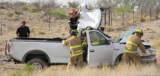Atoka volunteer firefighters move quickly to remove the hood of a silver pickup in order to extricate the driver inside. The pickup rolled off Seven Rivers Highway near mile marker 60 this morning. Aside from the Atoka Volunteer Fire Department, Artesia EMS, the Eddy County Sheriff's Office and the New Mexico State Police also responded to the one-vehicle accident. According to ECSO Capt. Jeff Zuniga, once the victim was taken out of the vehicle, he was airlifted to Lubbock, Texas, with a severe laceration to the head. The cause of the accident is currently being investigated by the State Police. The driver's name has not been released. Rob Larson – Daily Press