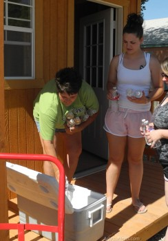 Tammy Neel, left, places water in a cooler at Rob's Trailers, another collection point for items to be delivered to Oklahoma tornado victims. Grace Miller - Daily Press