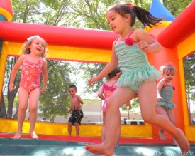 Sara Morgan, Sophia Sanchez, Macy Yates and Colton Pennington bounce away in a jump house at the end-of-year party for attendees of Dream Tenders preschool. Grace Miller – Daily Press
