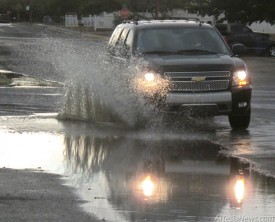 A vehicle splashes through a puddle along Texas Avenue Saturday afternoon following the second of the weekend's significant rainfalls, a welcome sight in parched Artesia. Brienne Green - Daily Press