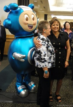 "Gov. Susana Martinez and Sen. Gay Kernan, pictured above with mascot Richie Enrichment, were on hand Thursday for a women's symposium, ""Creating Enriched Connections,"" in Hobbs, hosted by URENCO. The symposium was attended by 250 women, with Martinez delivering the keynote address. Kernan also spoke on how focus should be on forward motion and growth for women in their communities and the State of New Mexico.  Grace Miller – Daily Press"