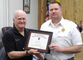 Mayor Phillip Burch presents a certificate to Fire Marshal James Abner in recognition of being professionally designated as a fire marshal by the Commission of Professional Credentialing in April. Abner is one of only 54 professionally designated fire marshals worldwide and the only individual within New Mexico to obtain this credential. Rob Larson – Daily Press
