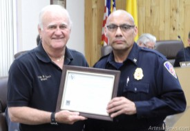 Mayor Phillip Burch awarding AFD Captain Eli Herrera with a certificate in recognition of becoming a Fire Officer IV during the Artesia City Council meeting on Tuesday night. In order to become a Fire Officer IV, Capt. Herrera had to complete an 80-hour certification course where he was required to develop his own 30-page strategic plan for the department and successfully pass a written exam. Rob Larson – Daily Press