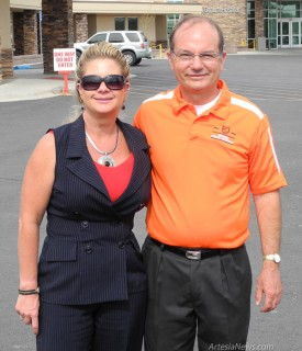Tammy Chavez, RN, BBA, of Artesia General Hospital and Artesia High School athletic director and football coach Cooper Henderson pose for a quick photo before the free sports physicals event at the hospital.  Rob Larson – Daily Press