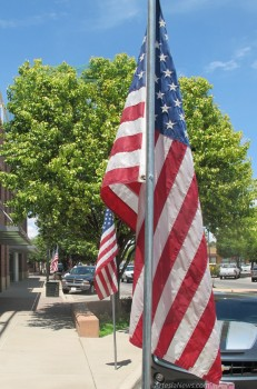 American flags line the sidewalks of Artesia's downtown district today in celebration of Flag Day. The flags are a courtesy of the Downtown Lions Club. Brienne Green - Daily Press
