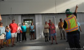 Construction manager Todd Casper takes a tour group around the main area giving members of the community a glimpse of what is to come. Liana Swarengin-The Artesia Daily Press