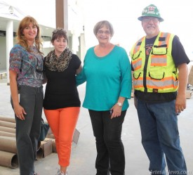 From left to right: Library Board Members  Rae Aaron, Rebecca Prendergast, and Sandi Lanning pose with Construction Manager Todd Casper during a community tour of the facilities on Monday evening. Liana Swarengin-The Artesia Daily Press