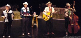 "The Riders in the Sky, from left, Joey ""the Cowpolka King"" Miskulin, Woody ""King of the Cowboy Fiddlers"" Paul, Ranger Doug, ""the Idol of American Youth,"" and Fred ""Too Slim"" LaBour, ""the Man of a Thousand Hats,"" yodel their way through a classic cowboy tune Saturday evening at the Ocotillo Performing Arts Center. The well-known group, which has two Grammy awards, nearly 300 national television appearances, and 700 appearances at the Grand Ole Opry to their credit, was making its fourth appearance in Artesia. Brienne Green - Daily Press"