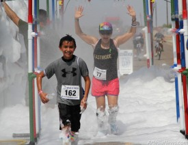 Above and at left, participants in the inaugural Wet 'n' Wild Ride, sponsored by Ride for Bikes, make their way through the Super Soaker gauntlet during the final leg of the event June 29 on Fairgrounds Road. Courtesy Photos