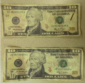 These bills, recovered by Artesia police this week, were checked with a pen. The color of the ink should have changed from red to black but did not on this counterfeit currency. Courtesy Photo