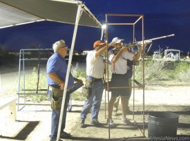 Grace Miller - Daily Press From left, Ed Garrett stands by as Greg Speck offers guidance to son Michael Friday evening during the Sporting Clays Fun Shoot at the Eddy County Shooting Range.